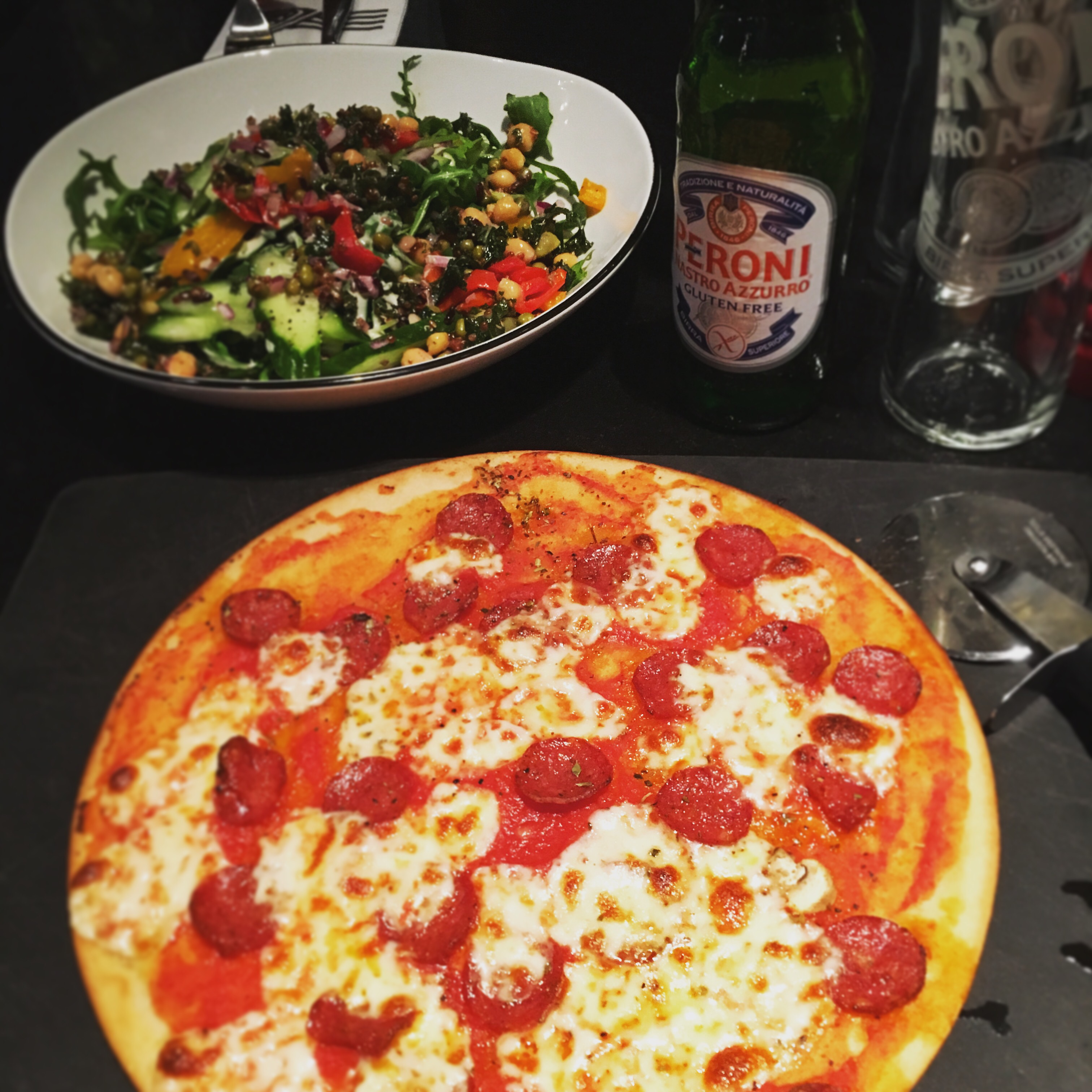 Pizza Express pizza, beer and salad.