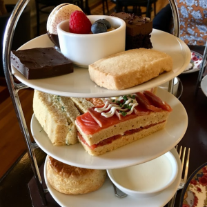 Scone, cakes and finger sandwiches